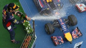 Daniel Riccardo showers his car with champagne.