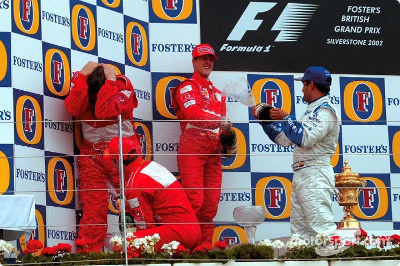 f1-british-gp-2002-the-podium-race-winner-michael-schumacher-with-rubens-barrichello-and-j